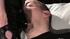 Bear with an appetite for cock gets fed by his leather daddy