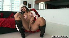 Busty MILF Monique Fuentes is a hot Christmas present with busy fingers